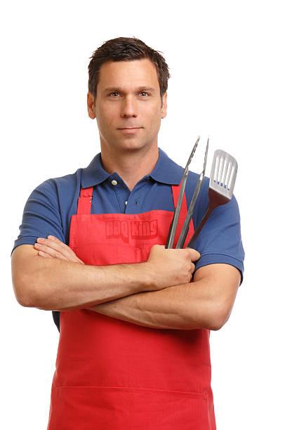 barbeque grill männlichen chef auf weiß - grillschürze stock-fotos und bilder