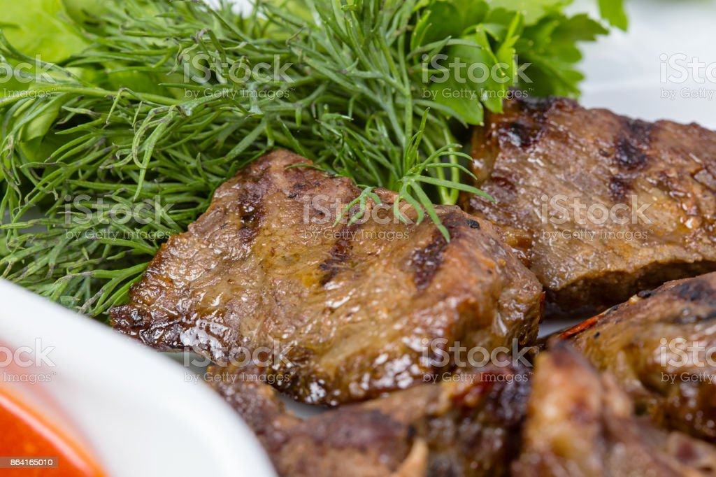Barbecue beef and green parsley royalty-free stock photo