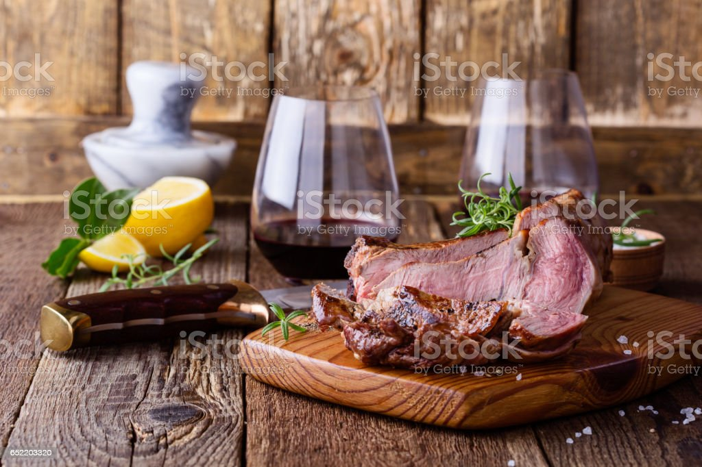 Barbecue bone ribeye steak on cutting board stock photo