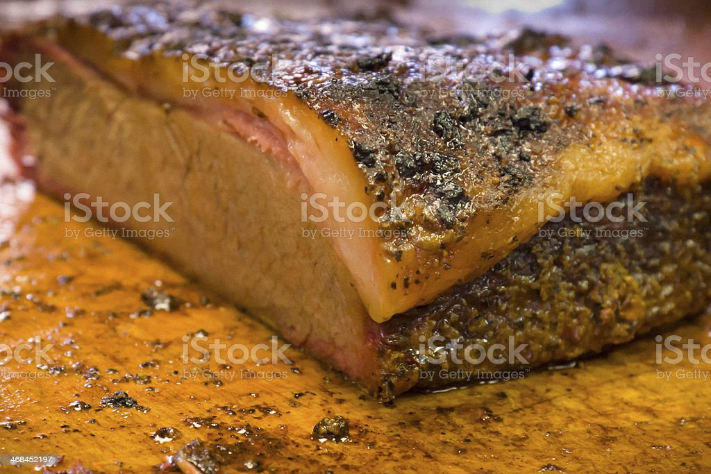 Barbecue brisket slab on cutting board royalty-free stock photo