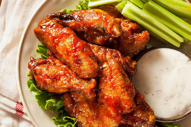 barbecue buffalo chicken wings - animal wing stock photos and pictures