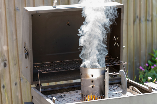 Barbecue charcoal starter chimney. This gadget creates an updraft to get charcoal lit and burning more quickly. It uses a firelighter at the base and the flames go up through the charcoal following the airflow.
