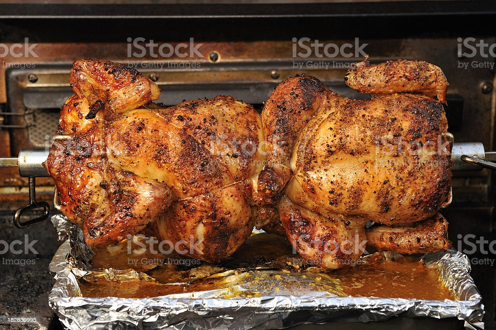 Barbecue Chicken, roasting jack, spit roasted, grill, outdoor home cooking stock photo