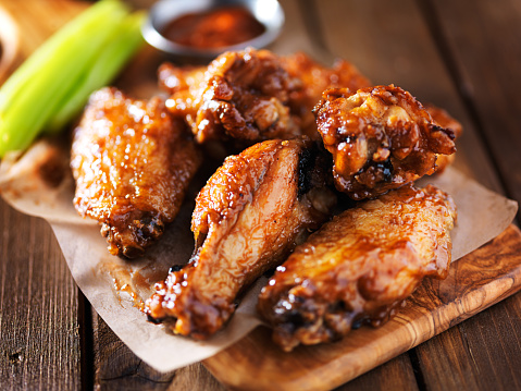 Barbecue Chicken Wings Close Up On Wooden Tray Stock Photo - Download Image Now