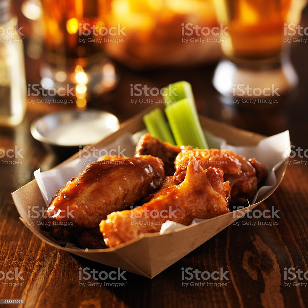 barbecue chicken wings in disposable tray stock photo