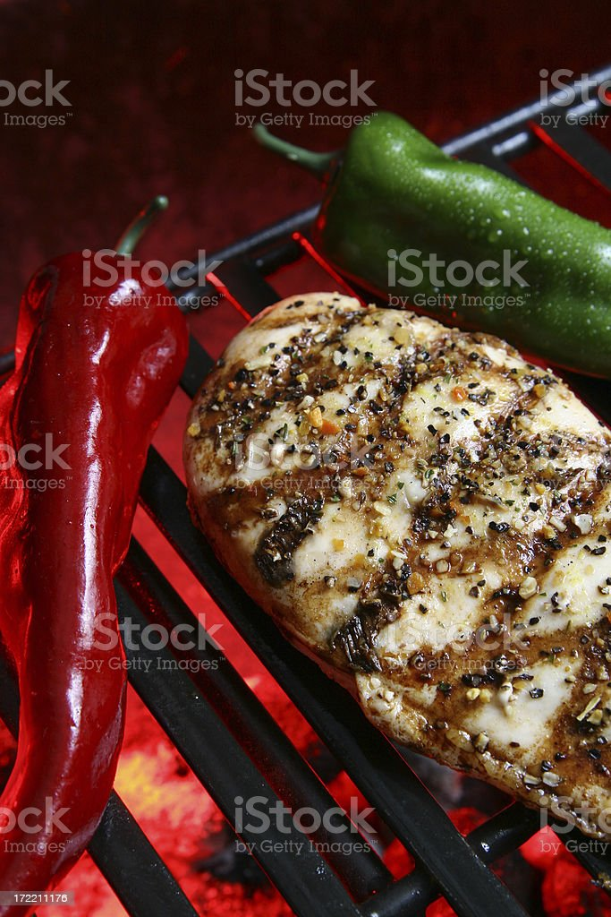 Barbecue chicken with peppers and spices royalty-free stock photo