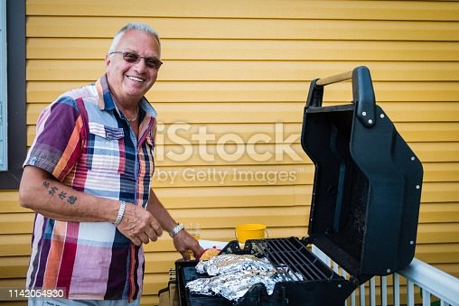 696841580istockphoto Barbecue during Mother's day with multigenerational family 1142054930