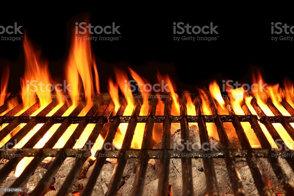 Barbecue Fire Grill Isolated On The Black Background, Close-up stock photo