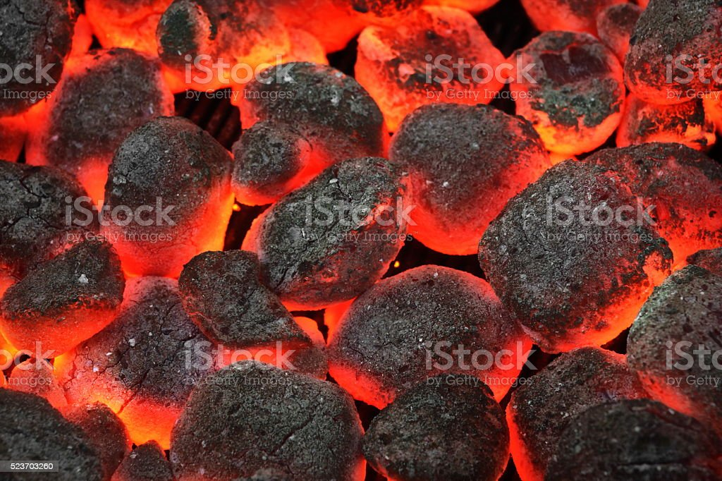 Barbecue Grill Pit With Glowing And Flaming Hot Charcoal Briquet stock photo