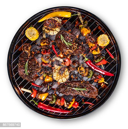 istock Barbecue grill with beef steaks, close-up 857569740