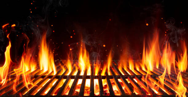 Barbecue Grill With Fire Flames - Empty Fire Grid On Black Background stock photo
