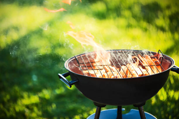 barbecue grill with fire - barbecue grill stock photos and pictures