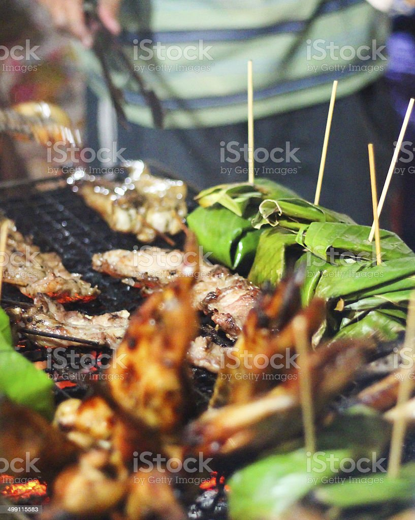 Barbecue Grilled Chicken, Banana Leaves - Street Food (Thailand) royalty-free stock photo