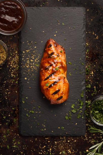Barbecue grilled chicken breast with seasoning stock photo