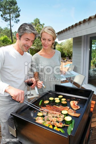 696841580istockphoto Barbecue in summer time 178629897