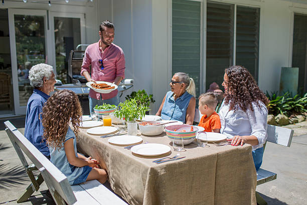 Barbecue lunch with all the family stock photo