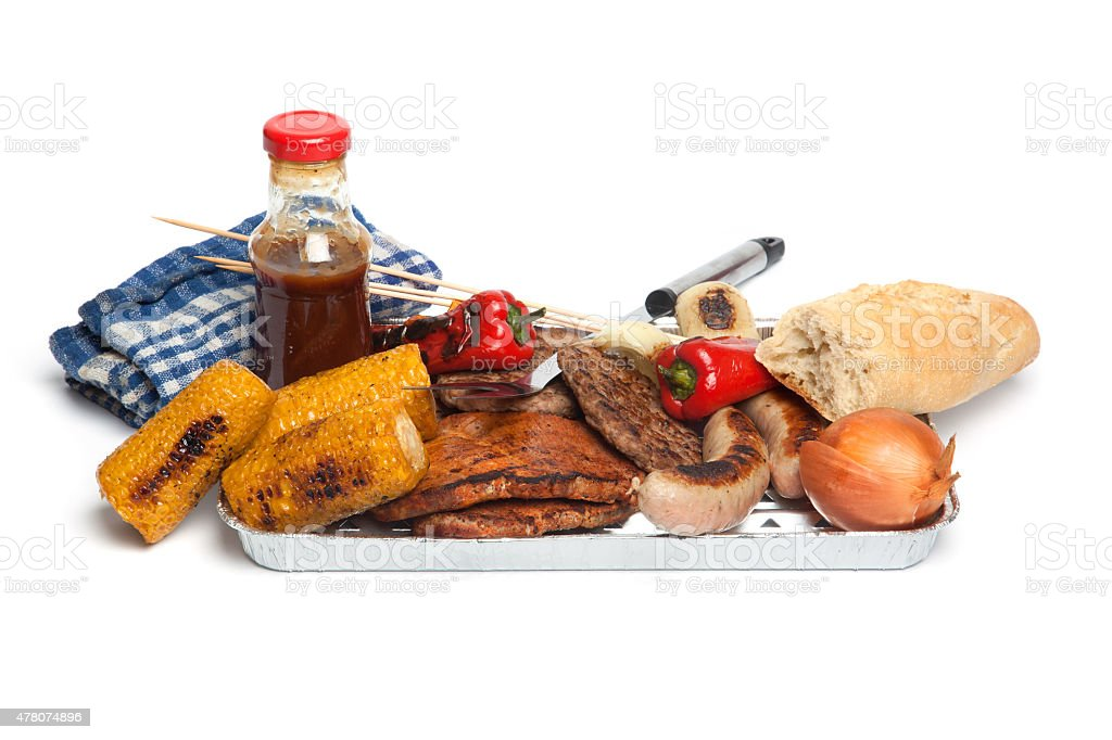 Barbecue, meat, corn, paprika on barbecue tray stock photo