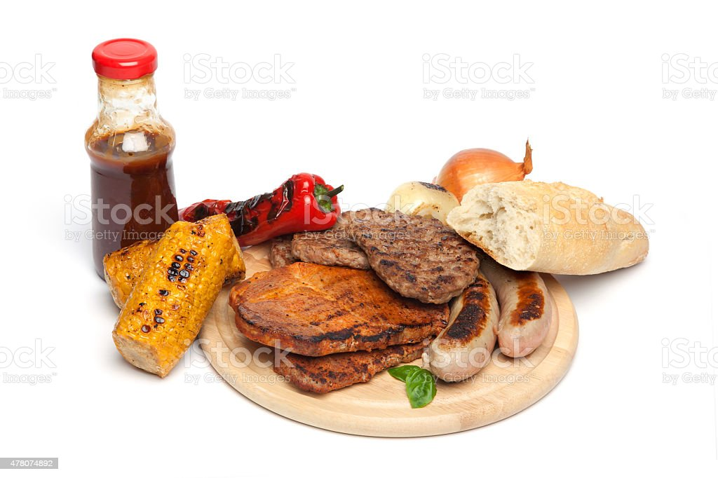 Barbecue, meat, corn, paprika on chopping board stock photo