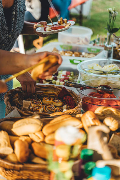Barbecue on a table in the garden with healthy vegetarian food stock photo