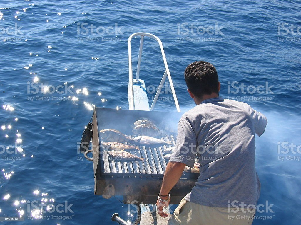 barbecue on the yacht stock photo