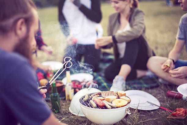Barbecue party in a park stock photo