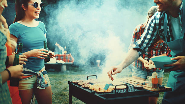 barbecue party. - barbecue grill stock photos and pictures