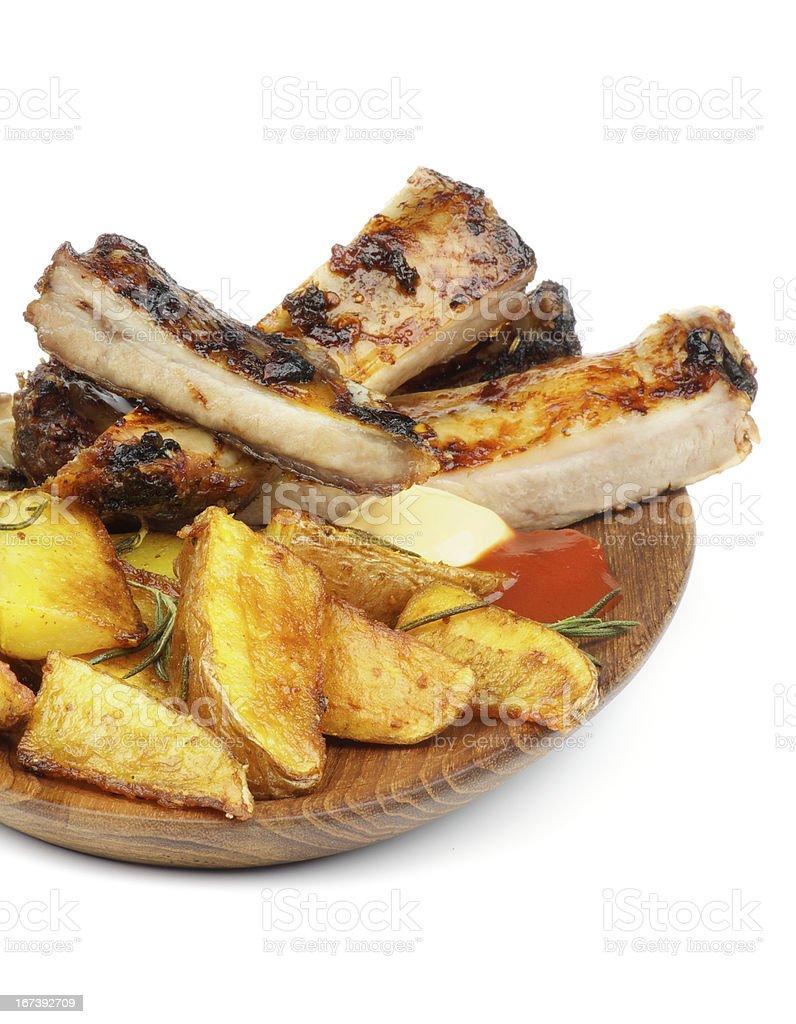 Barbecue Pork Ribs and Roasted Potato royalty-free stock photo