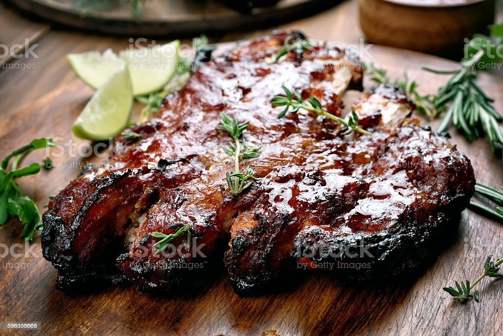Barbecue pork ribs on wooden board royalty-free stock photo