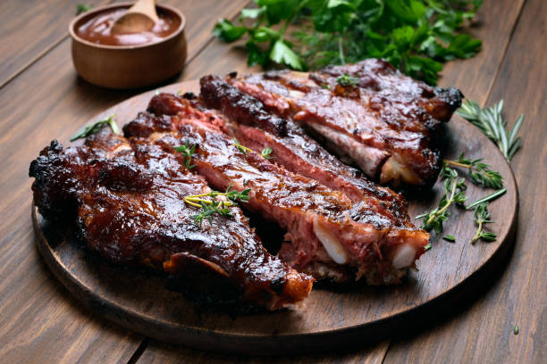 Barbecue pork ribs Grilled sliced barbecue pork ribs on wooden board pork stock pictures, royalty-free photos & images