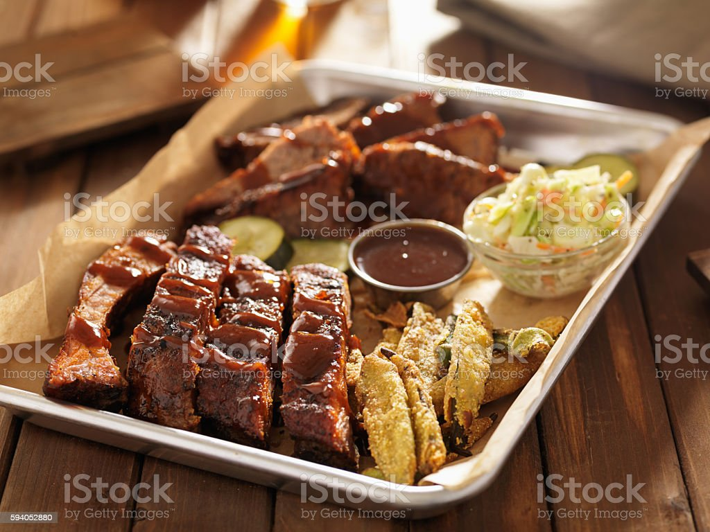 barbecue ribs with brisket, fried okrra and slaw stock photo