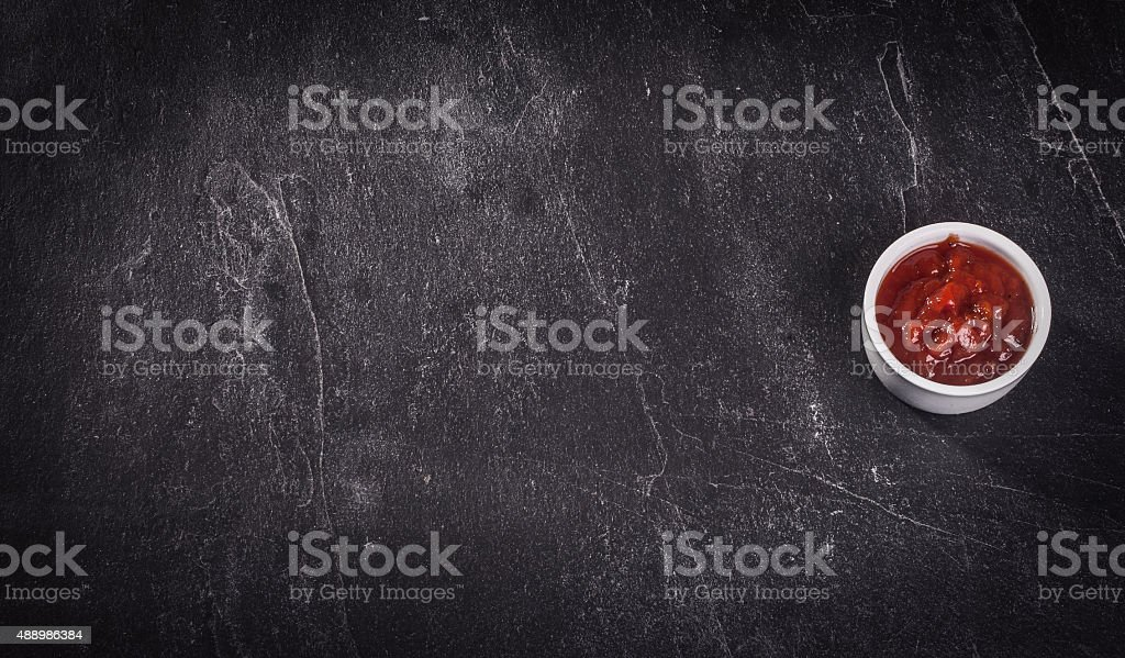 barbecue sauce over stone table with room for copy space stock photo