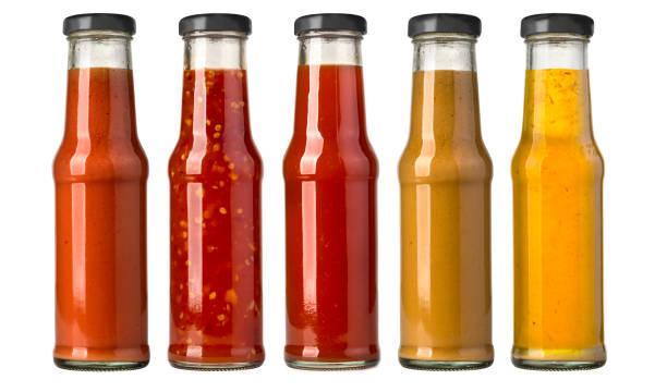 barbecue sauces in glass bottles the various barbecue sauces in glass bottles salsa sauce stock pictures, royalty-free photos & images