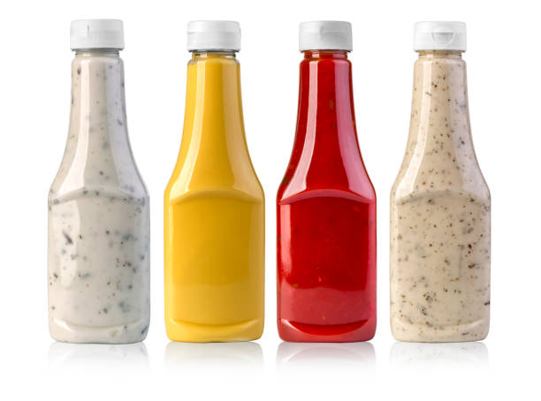 barbecue sauces in glass bottles stock photo