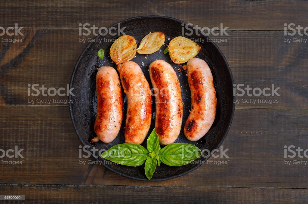Barbecue sausages in frying pan stock photo