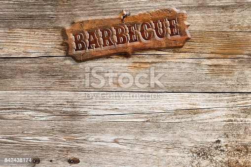 istock barbecue signboard on wooden wall 842438174