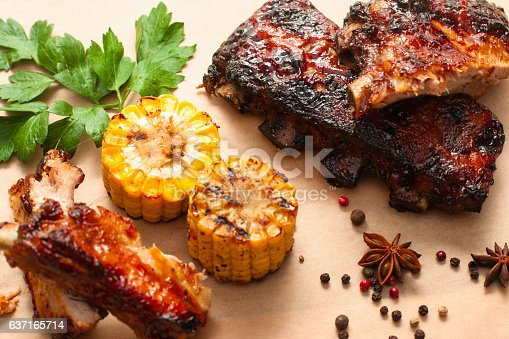 istock Barbecue spare ribs with corn on wood 637165714