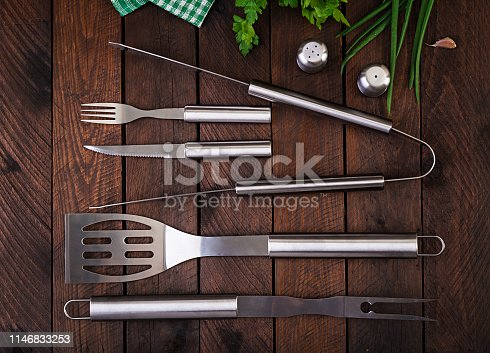 Barbecue Tools on wooden table. Flat lay, top view