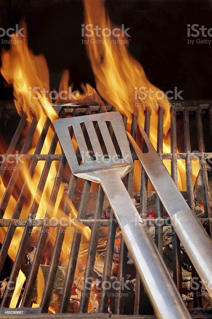 Barbecue Utensils on Hot cast iron Grate XXXL stock photo
