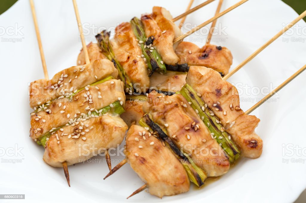 barbecue with delicious grilled meat and leek royalty-free stock photo