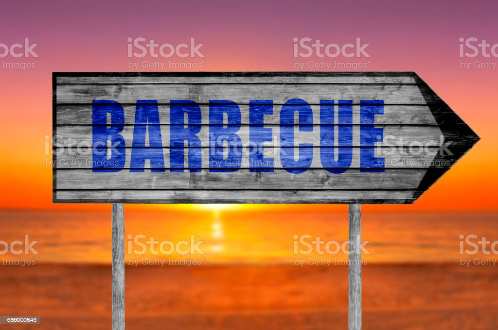 Barbecue wooden sign with a beach stock photo