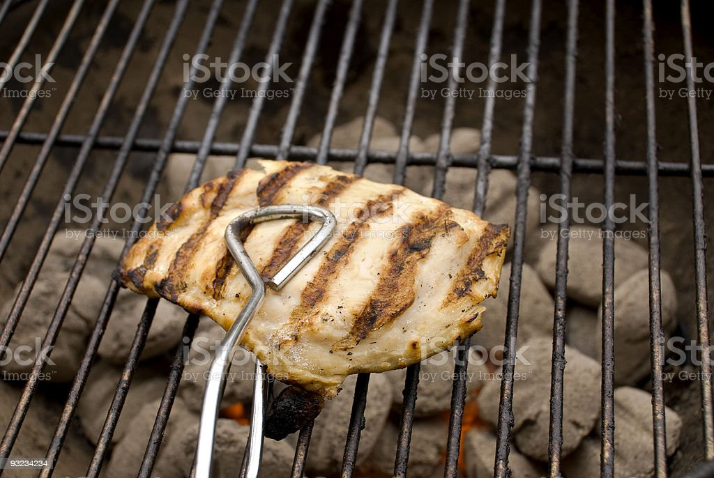 Barbecued chicken breast on barbecue royalty-free stock photo