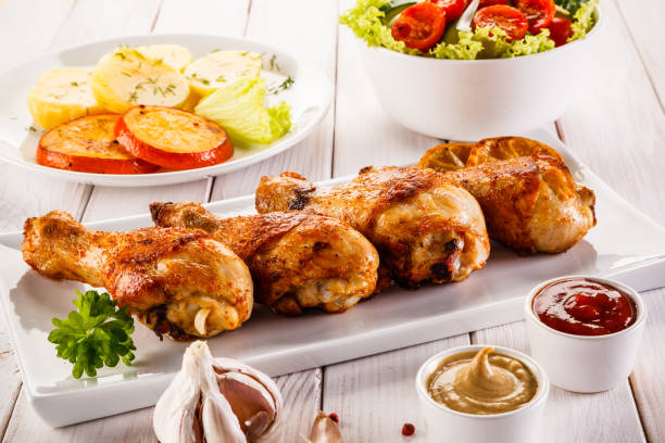 Barbecued chicken drumstick with vegetables Barbecued chicken legs with vegetables drumstick stock pictures, royalty-free photos & images