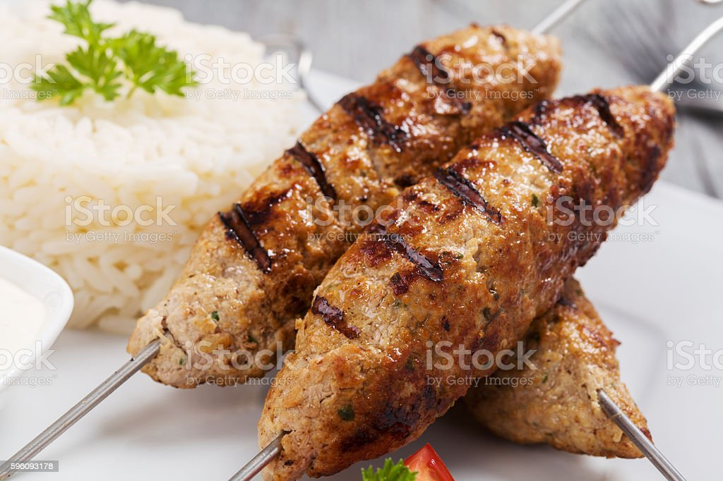 Barbecued kofta - kebeb with rice and vegetables royalty-free stock photo