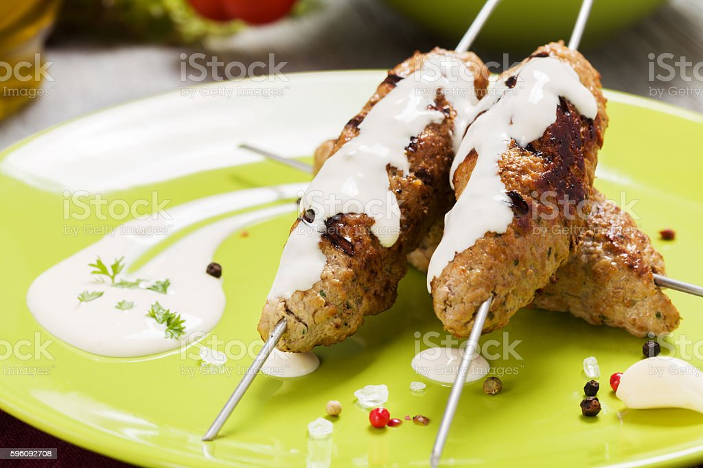 Barbecued kofta - kebeb with vegetables on a plate. royalty-free stock photo