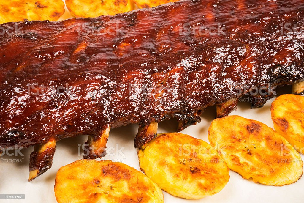 Barbecued Pork Baby Back Rib and Fried Plantains stock photo