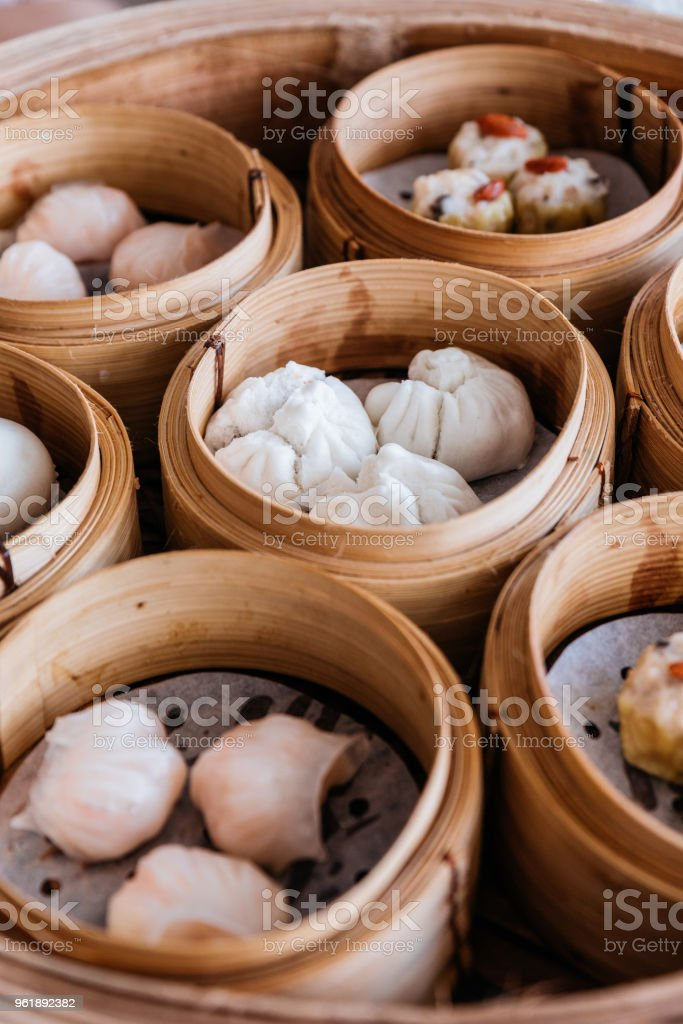 Barbecued pork buns served in steamer baskets with many kind of Dim sum. stock photo