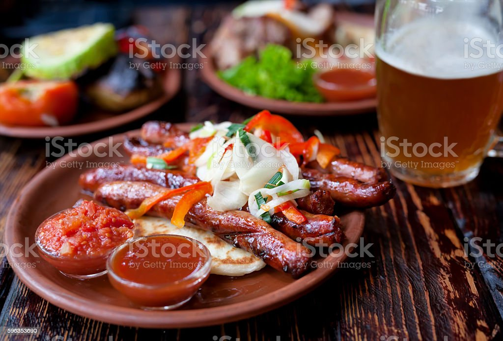 Barbecued pork or lamb meat sausages grill with salad royalty-free stock photo