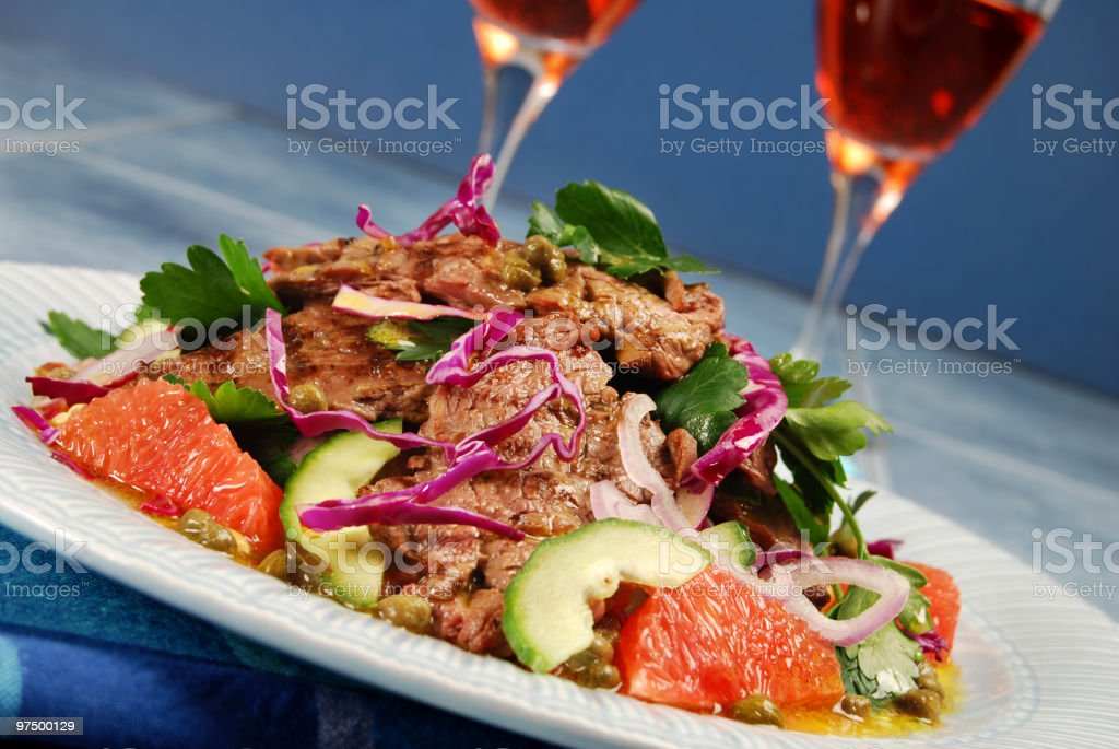 Barbecued steak salad and wine royalty-free stock photo
