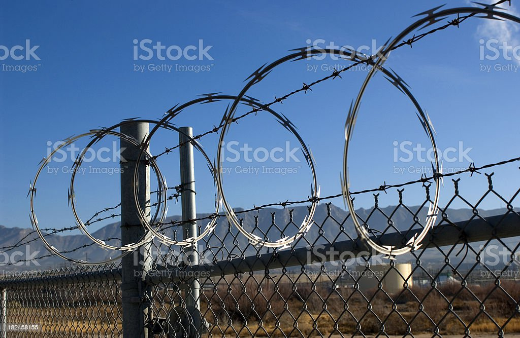 Barbed tape_Razor Wire Protects Water tank. royalty-free stock photo