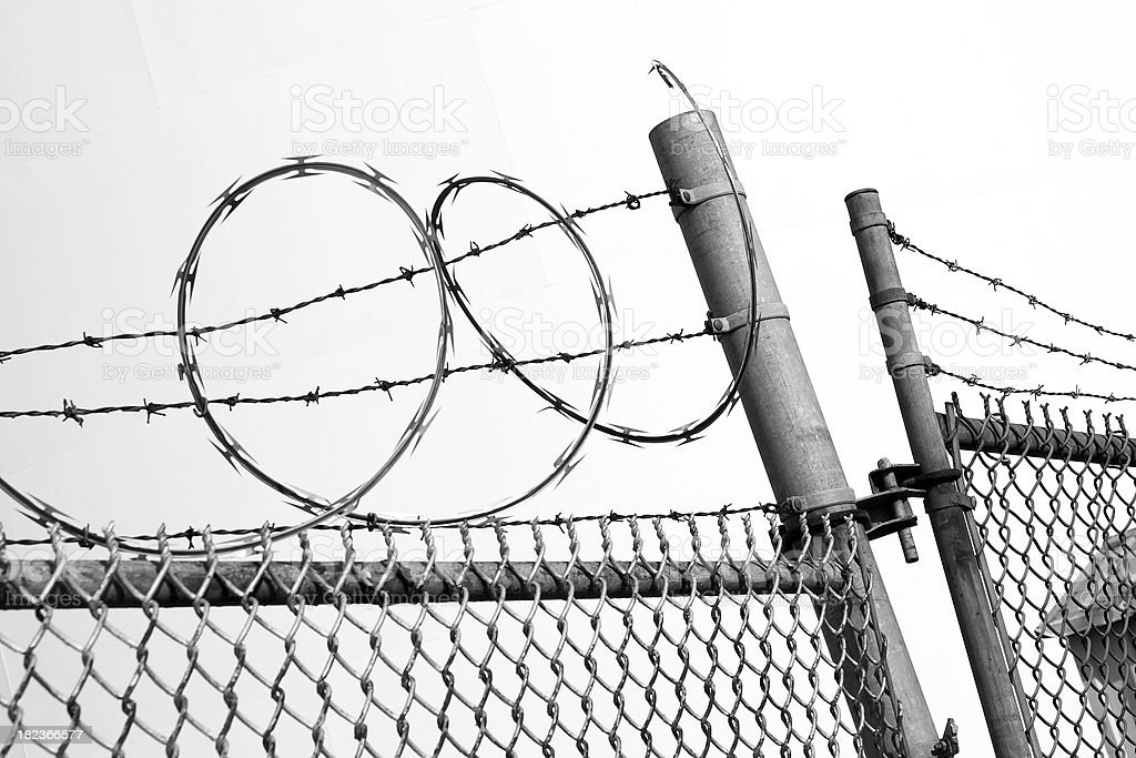 Barbed wire and chain link fence royalty-free stock photo